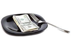 Banconote sul nero un piatto e una forcella Fotografia Stock Libera da Diritti