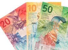 Banconote svizzere su fondo bianco fotografia stock