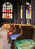 Bancos coloridos vazios da igreja Fotografia de Stock Royalty Free