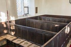 Bancos da caixa em uma capela unitária Foto de Stock Royalty Free
