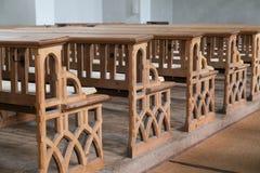 Bancos de madera en iglesia Imágenes de archivo libres de regalías