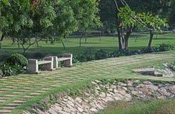 Bancos de parque de piedra Imagen de archivo libre de regalías