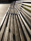 Bancos de parque no sol Foto de Stock Royalty Free