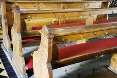 Bancos en una iglesia vieja Fotografía de archivo libre de regalías
