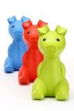 Bancos piggy vermelhos, verdes, azuis Fotos de Stock Royalty Free
