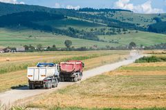Trucks in a row on rural road. royalty free stock photo