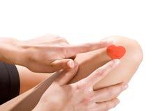 Band-aid en forme de coeur de colle Image libre de droits