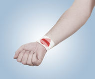 Band-aid on hand isloated on white background. Royalty Free Stock Photos