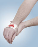 Band-aid on hand isloated on white background. Royalty Free Stock Photography