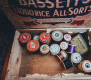 Band-aid Kit and Thread Reel on a Box Stock Images