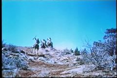 Band of Apache Indians on horseback on the warpath stock footage