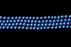 Band of blue beads over black Royalty Free Stock Photo