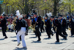 Band dances in parade Royalty Free Stock Image
