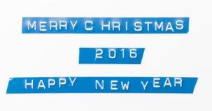 Band för etikett för lyckligt nytt år 2016 för glad jul Arkivfoto