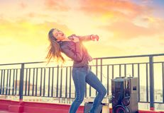 Band girl singing karaoke outdoor at roof terrace royalty free stock photography