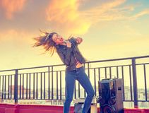 Band girl singing karaoke outdoor at roof terrace royalty free stock image
