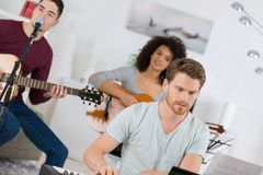 Band having rehearsal in house Royalty Free Stock Image