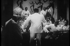 Band leader conducting musicians in1930s nightclub stock video footage
