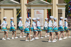 Band majorettes perform various dancing skills on city park Stock Images