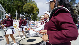 Band march girls playing drums. Some girls with his musical instruments ready to march in a local event in toluca mexico, young girls plays the drums of his Stock Photo