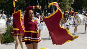 Band march girls in uniform dancing whit  flags Stock Image