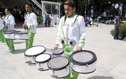Band march girls in uniform  playing drums. Some girls with his musical instruments ready to march in a local event in toluca mexico, young girls plays the drums Royalty Free Stock Photography