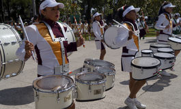 Band march girls in uniform playing drums. Some girls with his musical instruments ready to march in a local event in toluca mexico, young girls plays the drums Stock Images