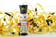 Band member decoration. Band member Christmas decoration with gold ribbon isolated on white Stock Photos