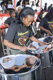 A band and member from Metronomes Steel Orchestra Stock Image