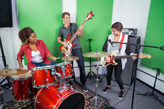 Band Members Performing In Recording Studio Royalty Free Stock Photo