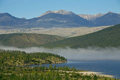 Band of mist over a mountain lake. Stock Images
