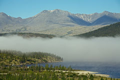 Band of mist over a mountain lake. Royalty Free Stock Photography