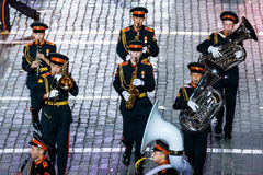 The Band of the Moscow Military Music College from Russia at the Red Square. MOSCOW, RUSSIA - AUGUST 26, 2016: Spasskaya Tower international military music Royalty Free Stock Photos