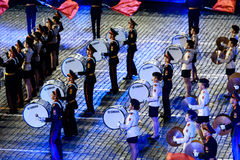 The Band of the Moscow Military Music College from Russia at the Red Square. MOSCOW, RUSSIA - AUGUST 26, 2016: Spasskaya Tower international military music Royalty Free Stock Images