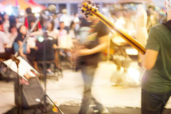 Band musician on street market, soft and motion blur Royalty Free Stock Photo