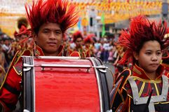Band musicians play bass drum during the annual brass band exhibition. San Pablo City, Laguna, Philippines - January 15, 2016: Band musicians play bass drum Stock Image