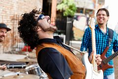 Crazy about music. Band of musicians playing in the street Stock Image