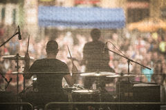 Band performing live on a stage. In front of huge crowd Royalty Free Stock Photo
