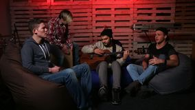 Band performing music unplugged in club stock footage