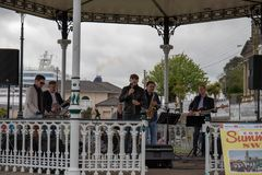 A band performing swing music in a fair during the bank holiday of May in Cobh stock images
