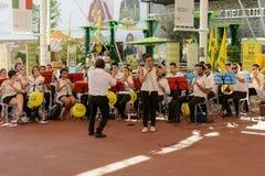 Band performing under Cardo shade, EXPO 2015 Milan Stock Photo