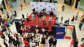The band performs at the opening of the supermarket stock video