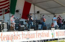 A Band Performs On Stage at The Memphis Italian Festival Sign Stock Images