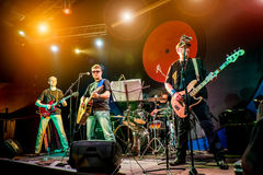 Band performs on stage in a nightclub. Band performs on stage, rock music concert in a nightclub Royalty Free Stock Photo