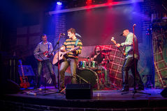 Band performs on stage Stock Images