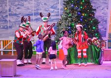 Band playing Christmas music and children dancing in International Drive area royalty free stock photography