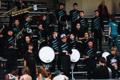Band playing at high school football game. The school band playing at the stands in a high school football game royalty free stock photo