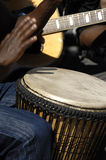 Band playing music. A street band is playing music. The hands har in motion blur Royalty Free Stock Photos