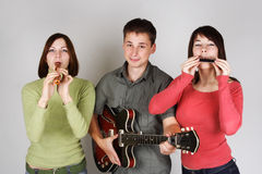 Band Playing On Flute, Harp And Guitar Stock Images