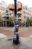 Band Posters Plastered on Lamp Post on Sixth Street in Austin During SXSW Royalty Free Stock Images
